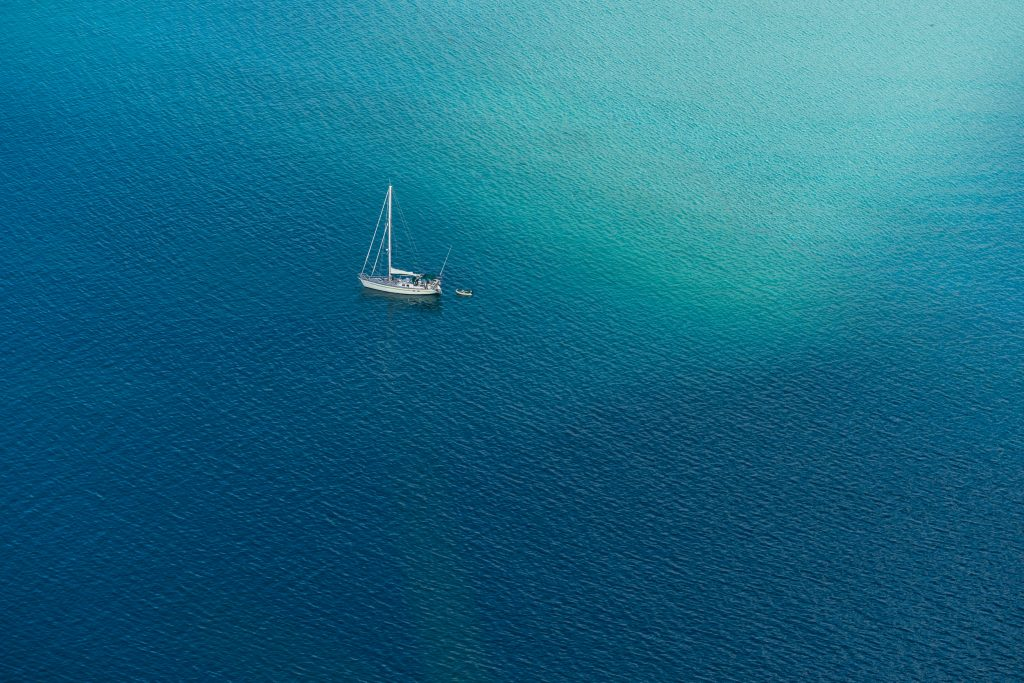 Sailing boat on the ocean, Maupiti.