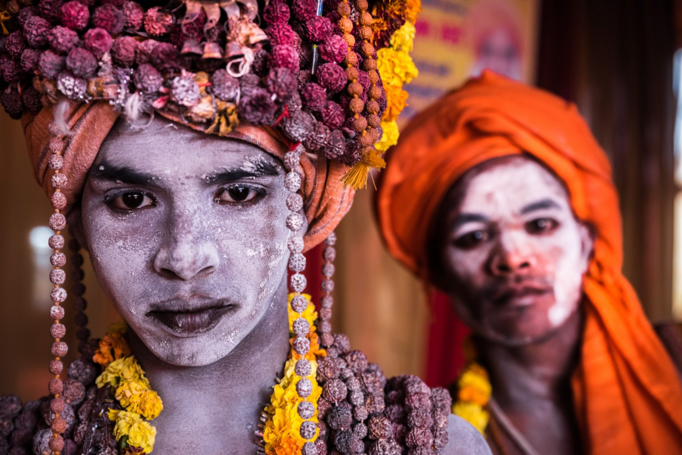 Two young Naga baba's pose in front of the camera, Kumbh mela, India.