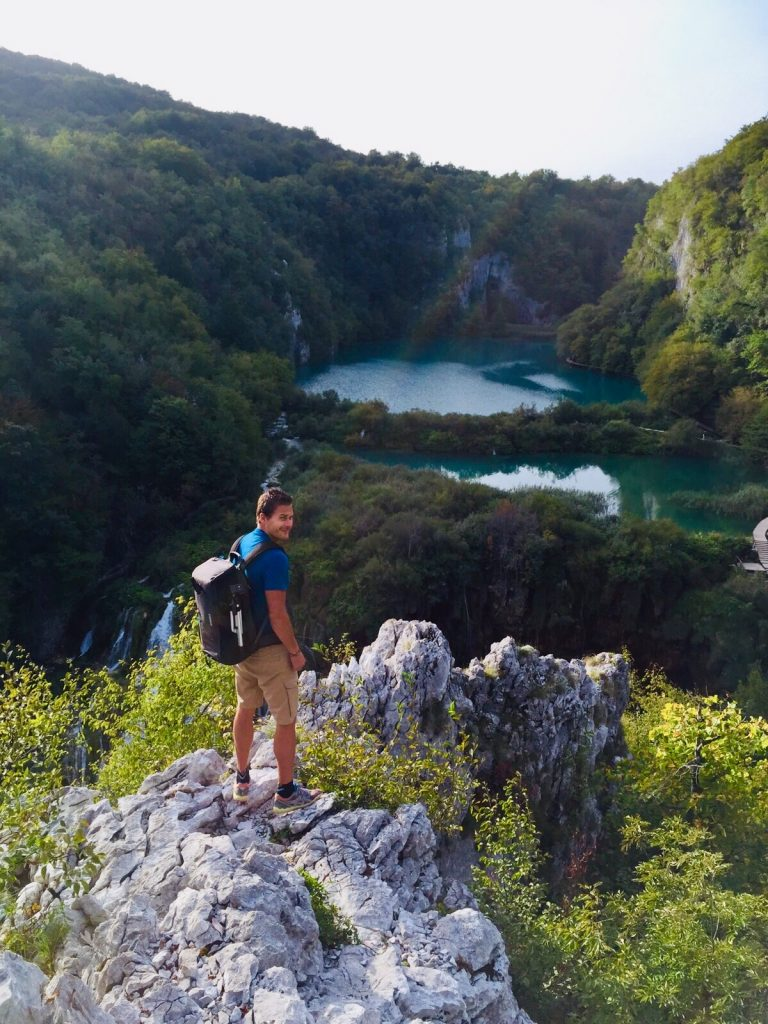 Gerben van der Waals with travelbag on a rock, Croatia.