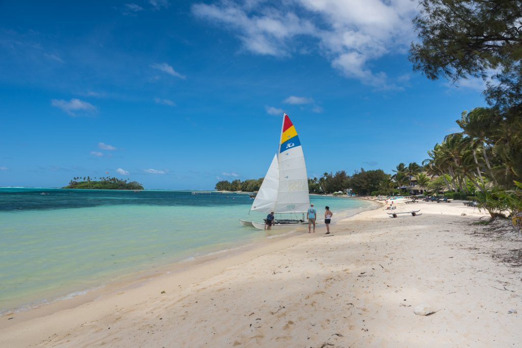 Wind surfer on the beach in the Cook islands,
